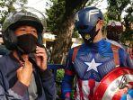 anggota-satlantas-polresta-solo-berkostum-captain-america-membagikan-masker-ke-pengguna-jalan.jpg