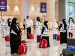anggota-tim-medis-kementerian-kesehatan-arab-saudi-di-bandara-internasional-king-abdulaziz-jeddah.jpg