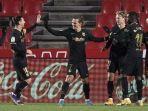 antoine-griezmann-tengah-merayakan-golnya-dalam-laga-granada-vs-barcelona-minggu-dini-hari-wib.jpg