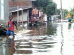 banjir-melanda-desa-jati-wetan-kecamatan-jati-kabupaten-kudus-rabu-2012021.jpg