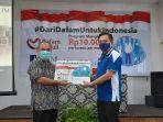 ceo-dhm-andhy-lrawan-memberikan-secara-simbolis-program-dari-dafam-untuk-indonesia.jpg