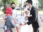 pengantin-di-salatiga-ini-bagikan-bingkisan-pernikahan-setelah-gagal-gelar-resepsi.jpg
