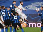 perebutan-bola-pemain-real-madrid-vs-inter-milan.jpg