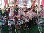 perwakilan-anak-yatim-menerima-sepeda-dari-lazisnu-kudus-selasa-2892021.jpg