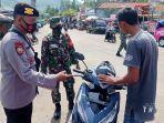 polisi-menegur-pengendara-motor-tak-bermasker-di-kecamatan-ayah-kebumen-senin-3082021.jpg