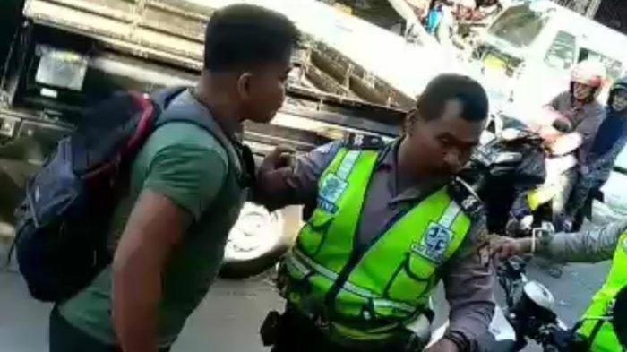 Viral Anggota Polisi Bertengkar hingga Bergulat dengan Pria Berbadan Kekar di Aspal, Ini Faktanya