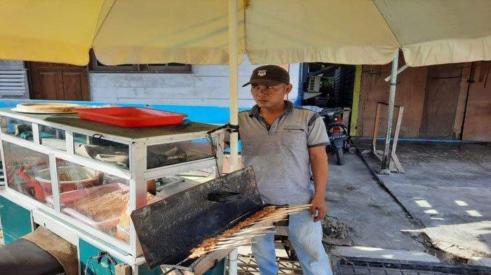 Kisah Syakur, Penjual Sate di Natuna Bertahan di Masa Pandemi Meski Sepi Pembeli