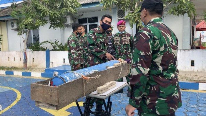 TNI AL Investigated Missile-like Foreign Object with Chinese Writing on Anambas Beach