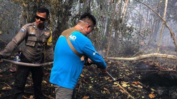 Pengalaman Relawan Singapura Ikut Padamkan Api di Lahan Gambut: Kita Seperti Tak Melakukan Apa-apa