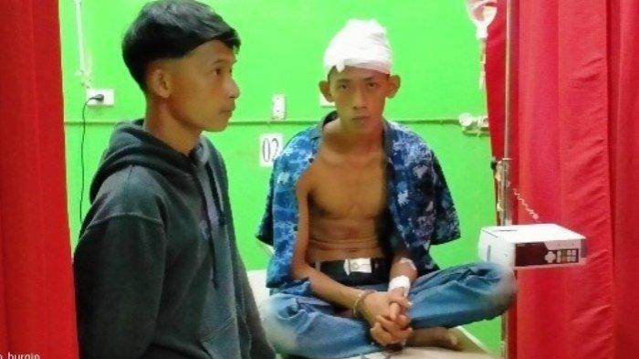 Warga Desa Labuhan Ratu Pasar Kecamatan Sungkai Selatan Kabupaten Lampung Utara, Candra yang mengaku dib**ok Irwan