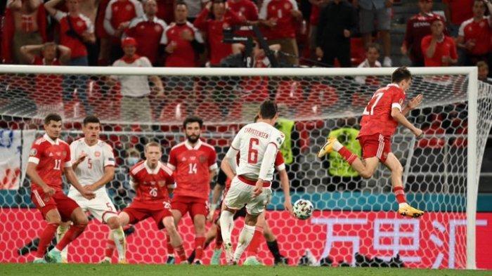 HASIL EURO 2020 - Timnas Denmark lolos secara dramatis ke babak 16 besar Euro 2020 setelah menekuk Rusia di laga terakhir penyisihan Grup C, Senin (21/6/2021) atau Selasa (22/6/2021) dinihari WIB.