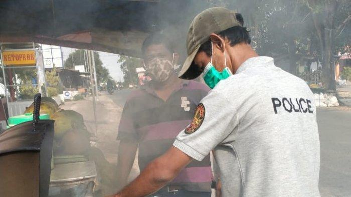 Foto 2 : Kelapa muda bakar milik Sihanto di Jalan Raya Sagulung Baru ( Sabuga) atau persis samping Klinik Utama Batuaji, Batam, Provinsi Kepulauan Riau
