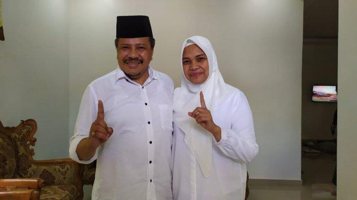 PILKADA BATAM - Lukita Dinarsyah Tuwo dan istri Anita Kentjanawati di Pilkada Batam setelah menggunakan hak pilihnya di TPS 037 Bengkong Sadai, Kota Batam, Provinsi Kepri, Rabu (9/12/2020).