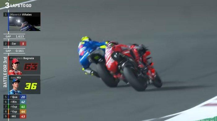 Momen saat Joan Mir melewati Francesco Bagnaia di MotoGP Qatar 2021, Minggu (28/3/2021)