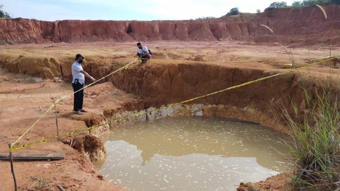 Kolam bekas galian pasir di Batu Besar, Kecamatan Nongsa, Batam, Jumat (16/7/2021). Di lokasi ini, dua pelajar tewas tenggelam.