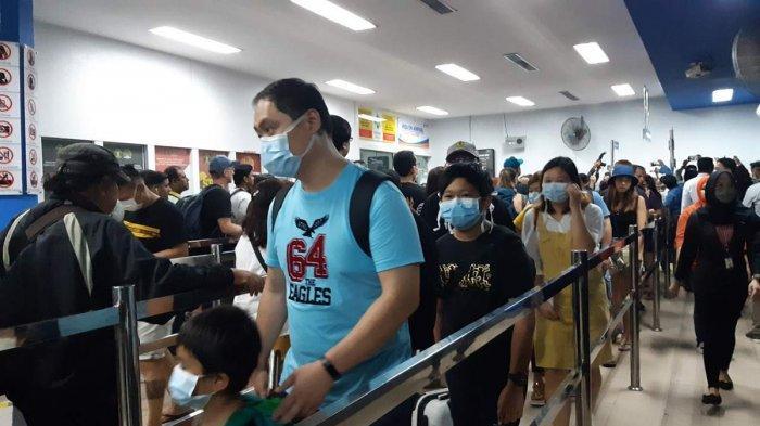 Anticipating Corona Virus, Passengers at Batam Center International Port Wear Masks