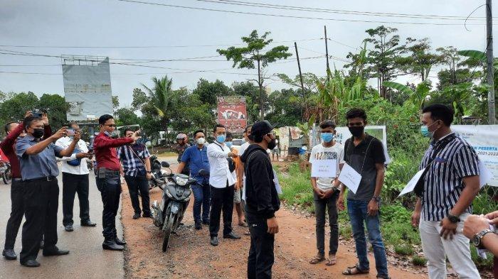 Rekonstruksi pembunuhan pegawai Ditpam BP Batam di Kampung Bagan, Tanjung Piayu, Kecamatan Sei Beduk, Kamis (25/3/2021).