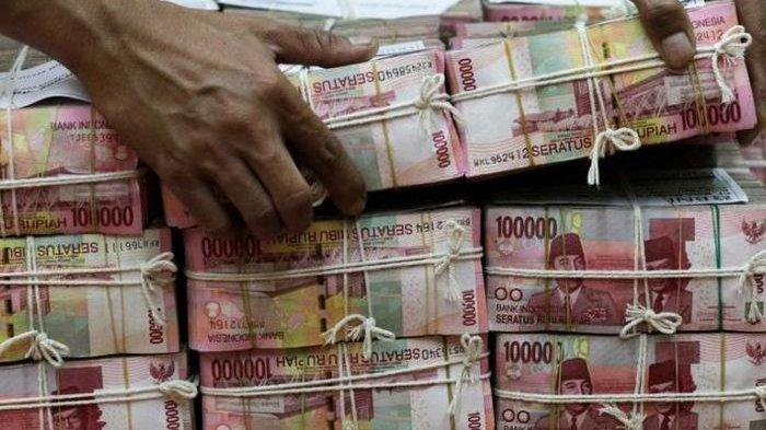 Ilustrasi tumpukan uang rupiah