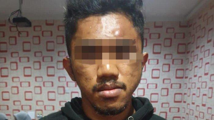 Salah seorang tersangka penyelundupan ekstasi asal Malaysia yang dibekuk Mabes Polri dan Bea Cukai Batam.