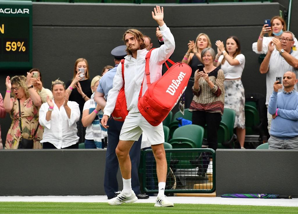 Petenis Yunani Stefanos Tsitsipas sudah terhenti di babak pertama Wimbledon 2021 setelah kalah dari petenis AS Frances Tiafoe.