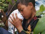 0207_rohani_seorang-anak-berdoa-dengan-khusyuk.jpg