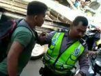 05-07-2019-video-perkelahian-antara-polisi-lalu-lintas-dengan-seorang-pria-berbadan-kekar.jpg