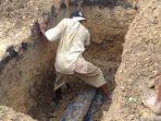 16-10-2020-ilustrasi-penggali-kubur-makam-makam-terbongkar-kuburan.jpg