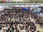 aksi-unjuk-rasa-di-hongkong-international-airport-beberapa-pekan-lalu.jpg
