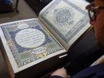 al-quran-buatan-tangan-yang-dibuat-dari-kain-sutra_20180523_175826.jpg