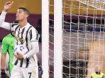 cristiano-ronaldo-mencetak-dua-gol-ke-gawang-as-roma-minggu-27-september.jpg