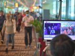 ilustrasi-para-calon-penumpang-di-bandara-singapura.jpg