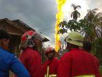 kebakaran-sumur-minyak-di-desa-pasi-putih-kabupaten-aceh-timur_20180426_072218.jpg