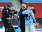 manajer-manchester-city-asal-spanyol-pep-guardiola-memeluk-pemainnya-joao-cancelo.jpg