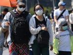 pelancong-memakai-masker-saat-berada-di-singapura.jpg