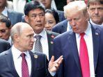 presiden-as-donald-trump-kanan-bersama-presiden-rusia-vladimir-putin_20171111_172405.jpg