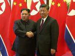 presiden-china-xi-jinping-kanan-dan-pemimpin-korea-utara-kim-jong-un_20180328_121354.jpg