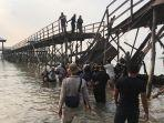 puluhan-wna-terjatuh-ke-dalam-air-pasca-jembatan-montigo-resort-roboh2.jpg