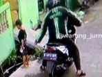 seorang-penjambret-yang-mengenakan-jaket-berlogo-grabike-terekam-cctv.jpg