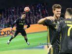 striker-juventus-cristiano-ronaldo-cetak-gol-ke-gawang-ajax-amsterdam.jpg
