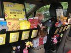 taksi-di-cina-kini-banyak-yang-diubah-menjadi-toko-serba-ada_20180407_131622.jpg