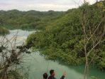 warga-melihat-genangan-menyerupai-danau-di-gunungkidul_20171203_124524.jpg