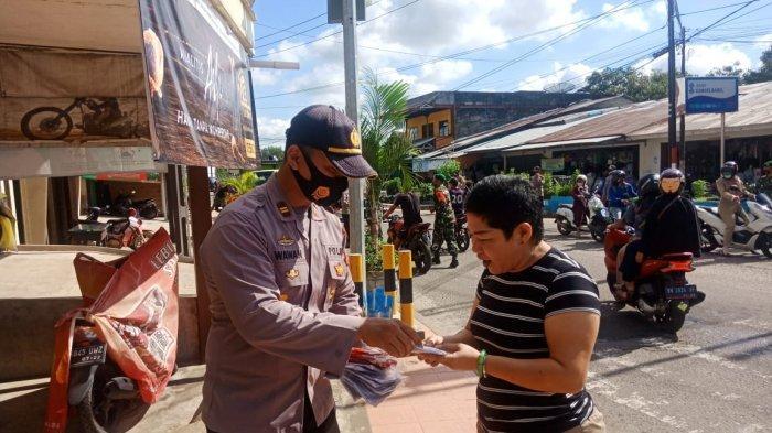 Sinergisitas TNI dan Polri, Bagikan 500 Masker untuk Masyarakat Gantung