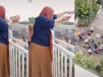20210509-viral-wanita-bagi-bagi-uang-100-juta-dari-balkon.jpg