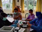 20210901-suasana-vaksinasi-massal-di-kantor-desa-juru-seberang-kecamatan-tanjungpandan.jpg
