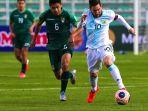 aksi-lionel-messi-timnas-argentina-vs-bolivia-01.jpg