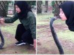 gadis-cium-ular-kobra.jpg