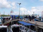 kapal-nelayan-mengangkut-penumpang-jamaah-tabliq-diamankan-di-pelabuhan-tanjungpandan.jpg
