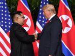 pemimpin-korea-utara-kim-jong-un-kiri_20180612_134506.jpg