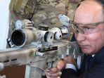 presiden-rusia-vladimir-putin_20180921_094953.jpg