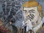 seorang-pria-palestina-berjalan-melewati-grafiti.jpg